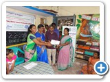 Mr. D. Siva Arun, Programme Assistant, ENVIS Centre distributing certificates and gifts to prize winner